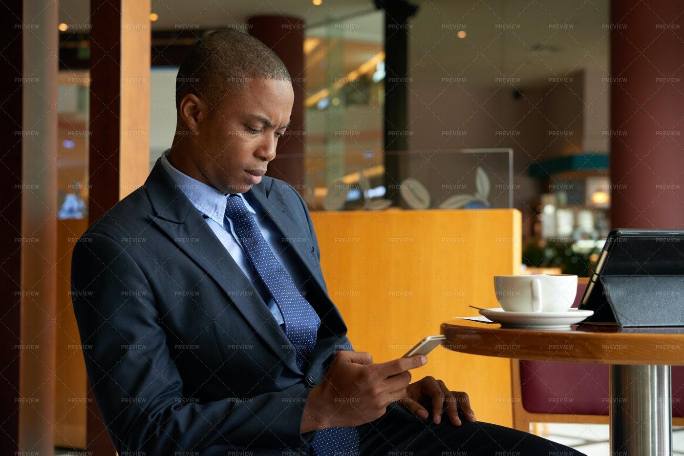 Texting Serious Entrepreneur: Stock Photos