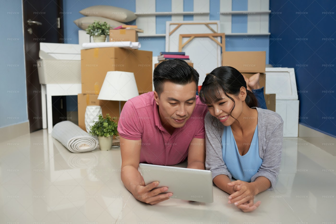 Couple Resting In New Apartment: Stock Photos