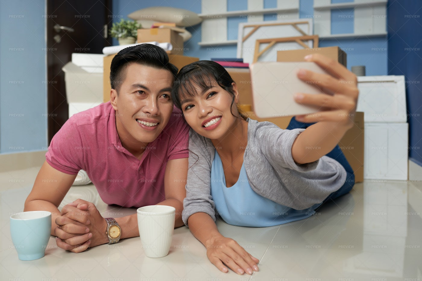 Couple Taking Selfie In New Flat: Stock Photos