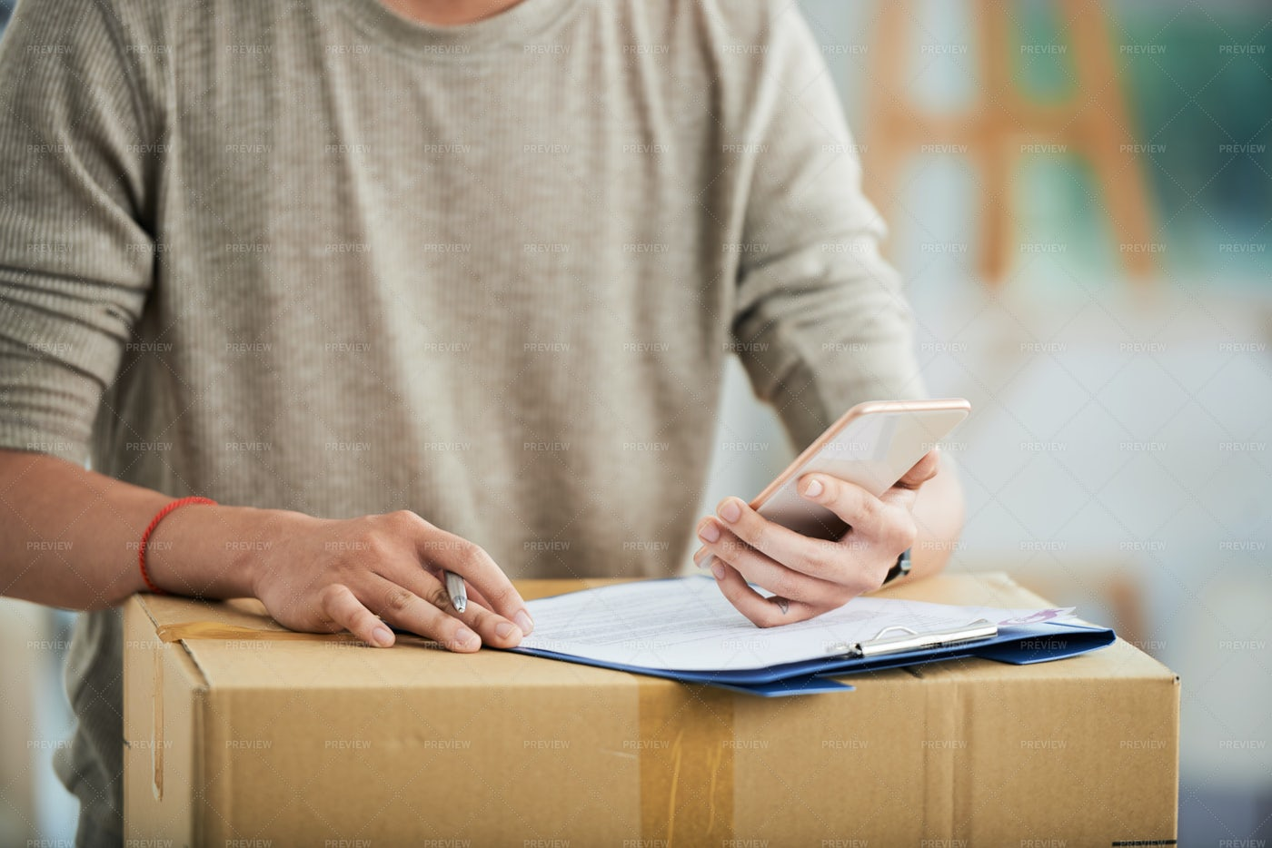 Male With Clipboard And Carton...: Stock Photos