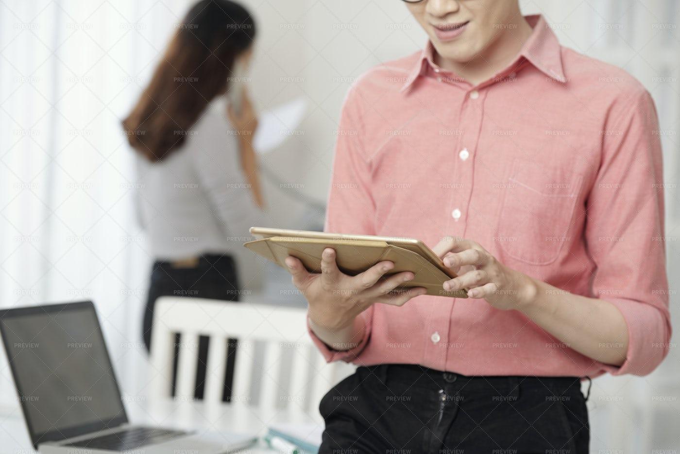 Crop Modern Man Using Tablet At...: Stock Photos