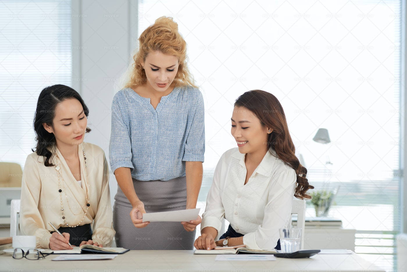 Reading Document To Coworkers: Stock Photos