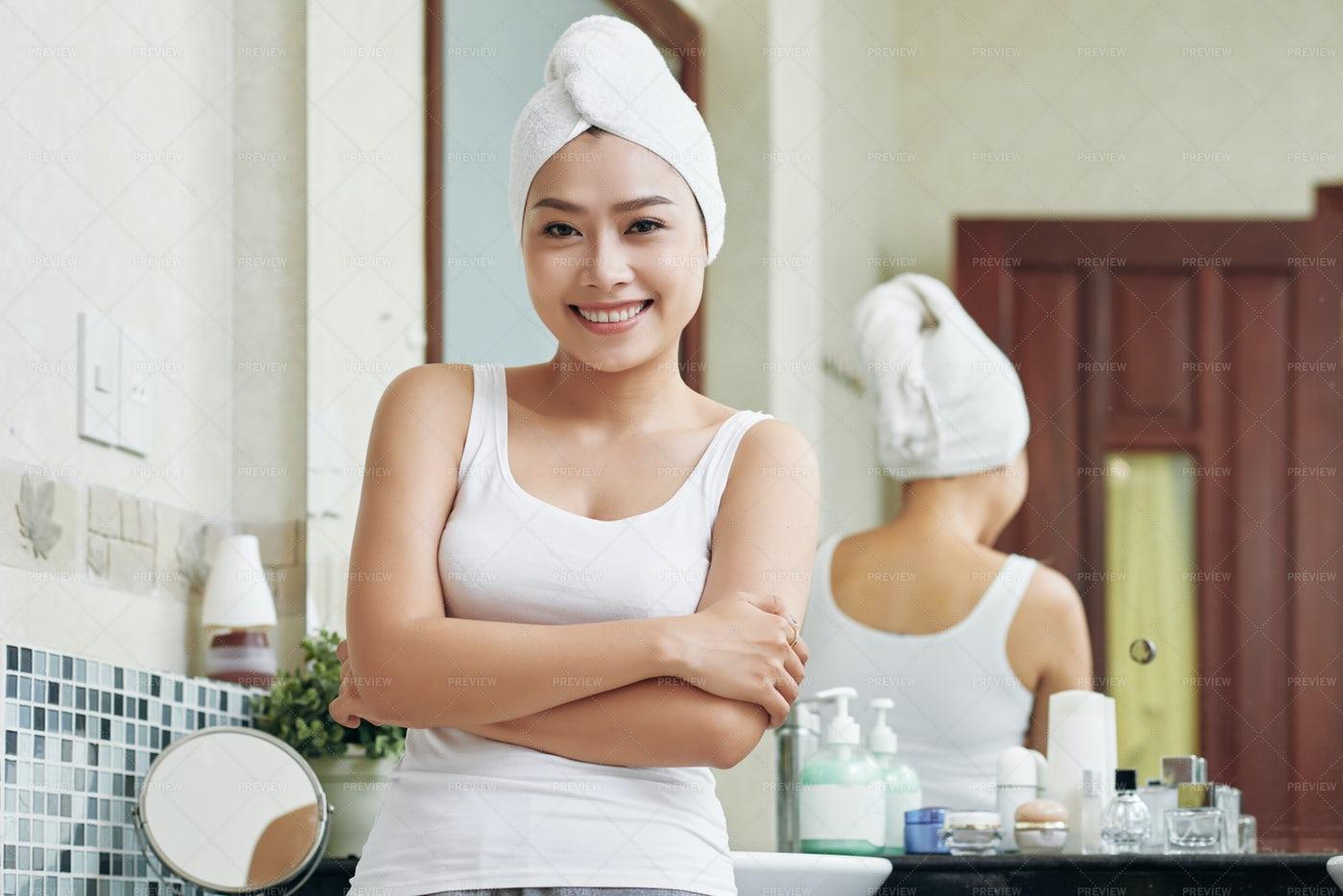 Ethnic Woman Standing In Bathroom: Stock Photos