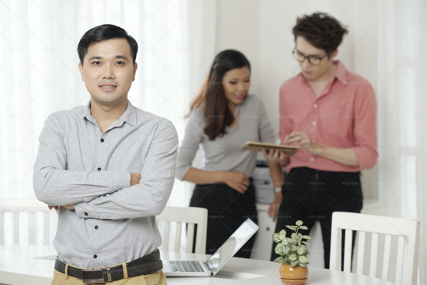 Professional Ethnic Worker With...: Stock Photos