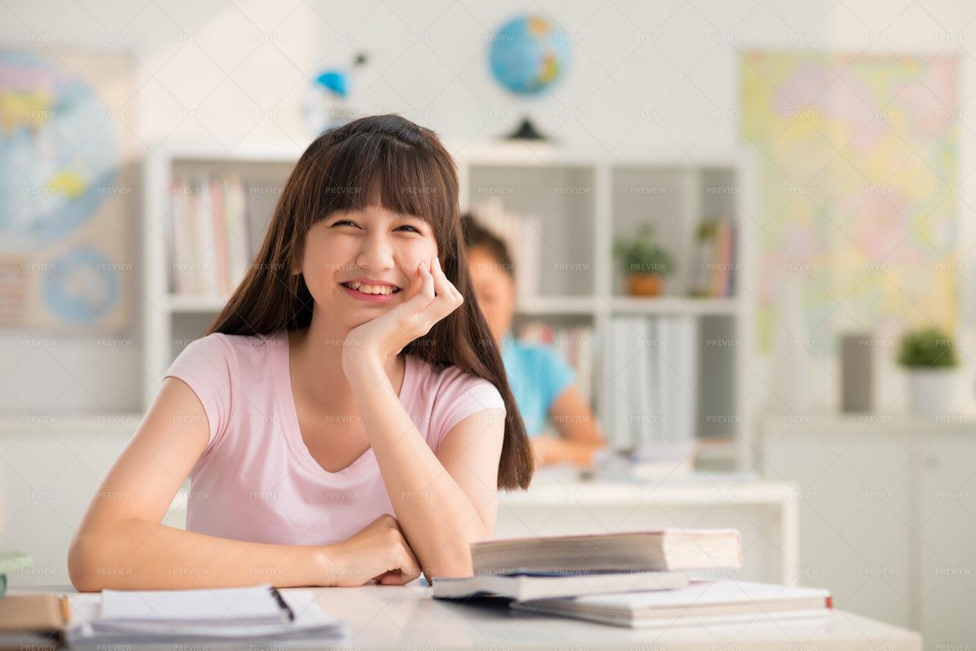 Happy Teenage Pupil In Classroom: Stock Photos