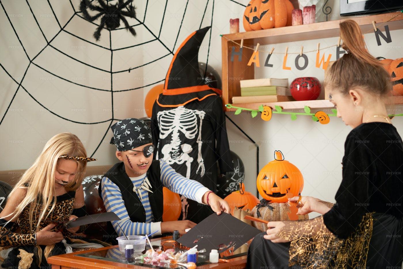 Kids Making Halloween Handicrafts: Stock Photos