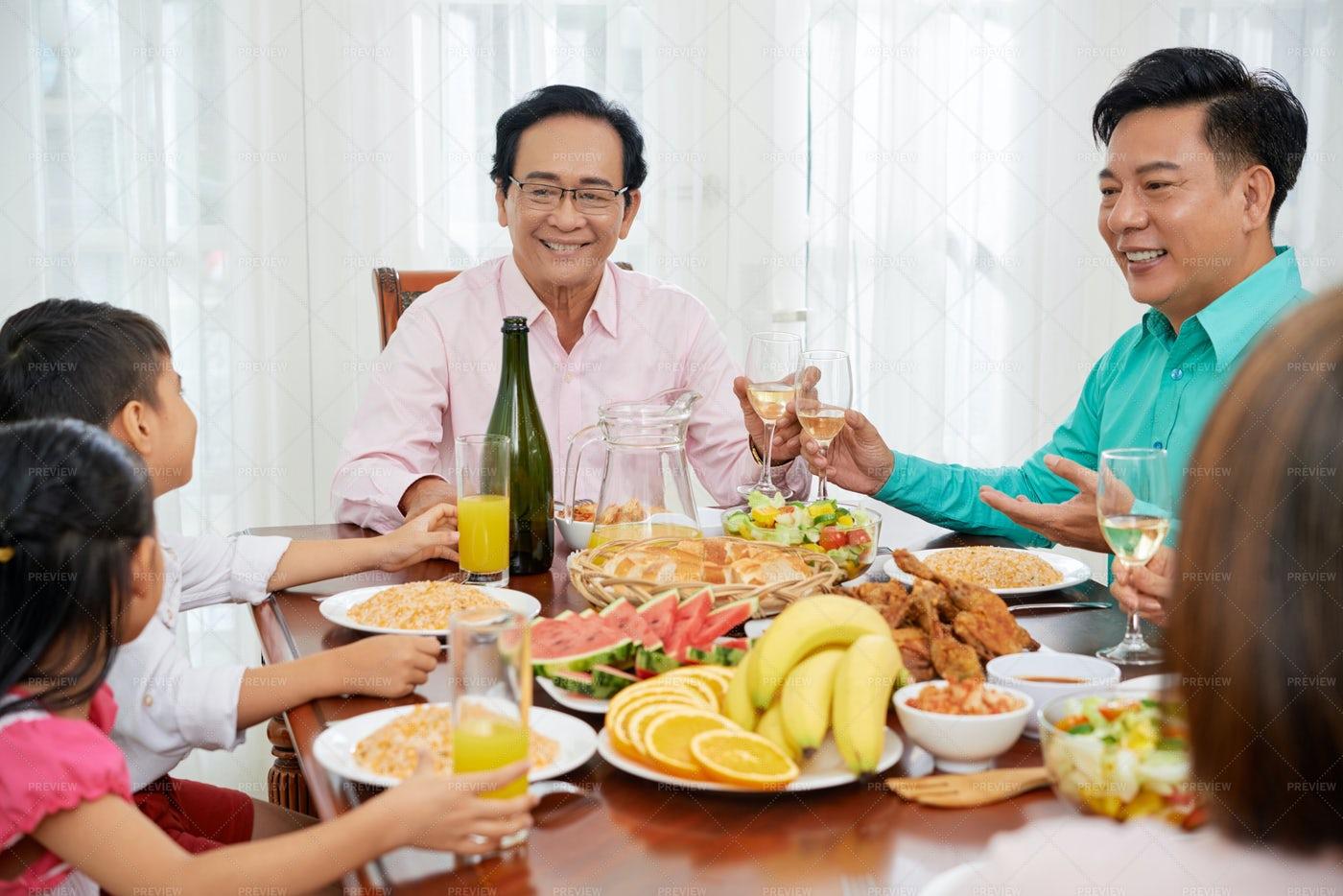Family Celebrating Dinner: Stock Photos