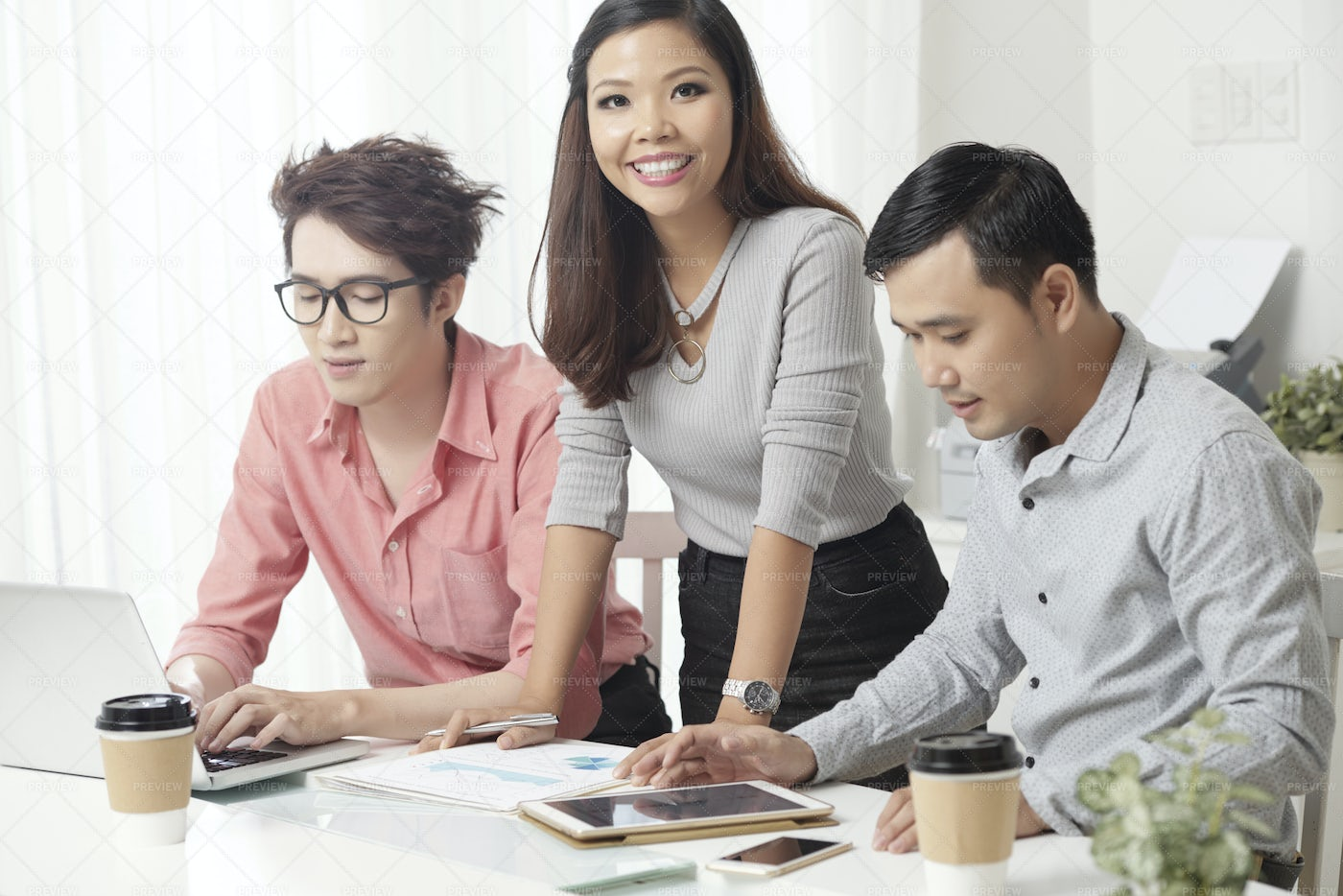 Smiling Woman With Male Colleagues...: Stock Photos