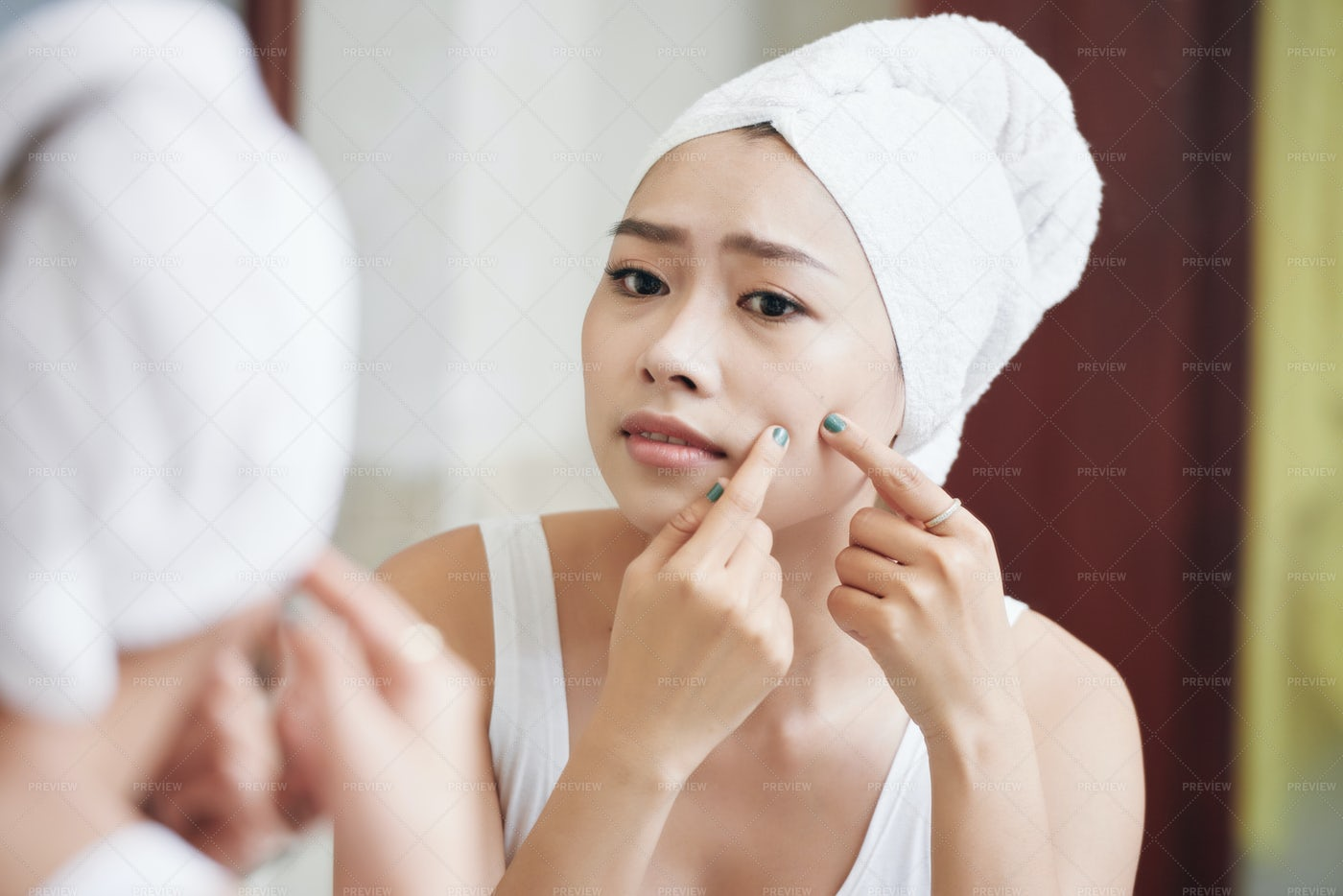 Asian Woman Popping Pimples In...: Stock Photos
