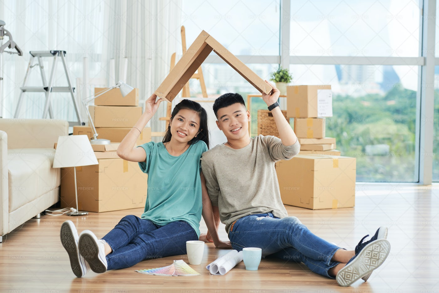 Couple Playing With Cardboard On...: Stock Photos