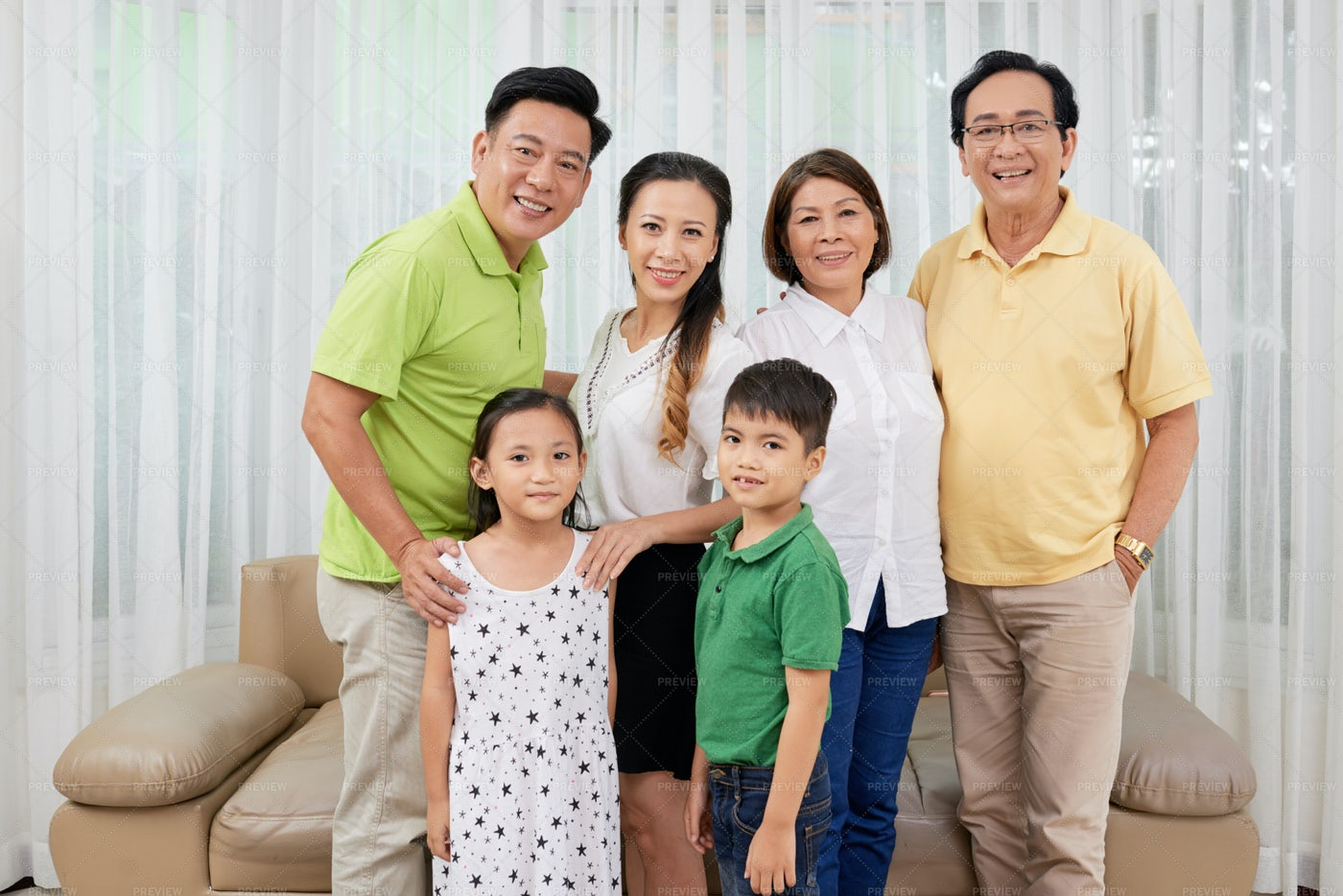 Family Gathered At Home: Stock Photos
