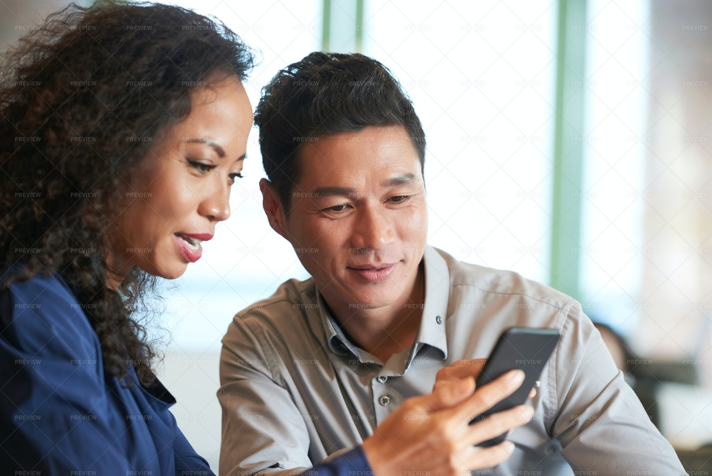 Reading News In Smartphone: Stock Photos