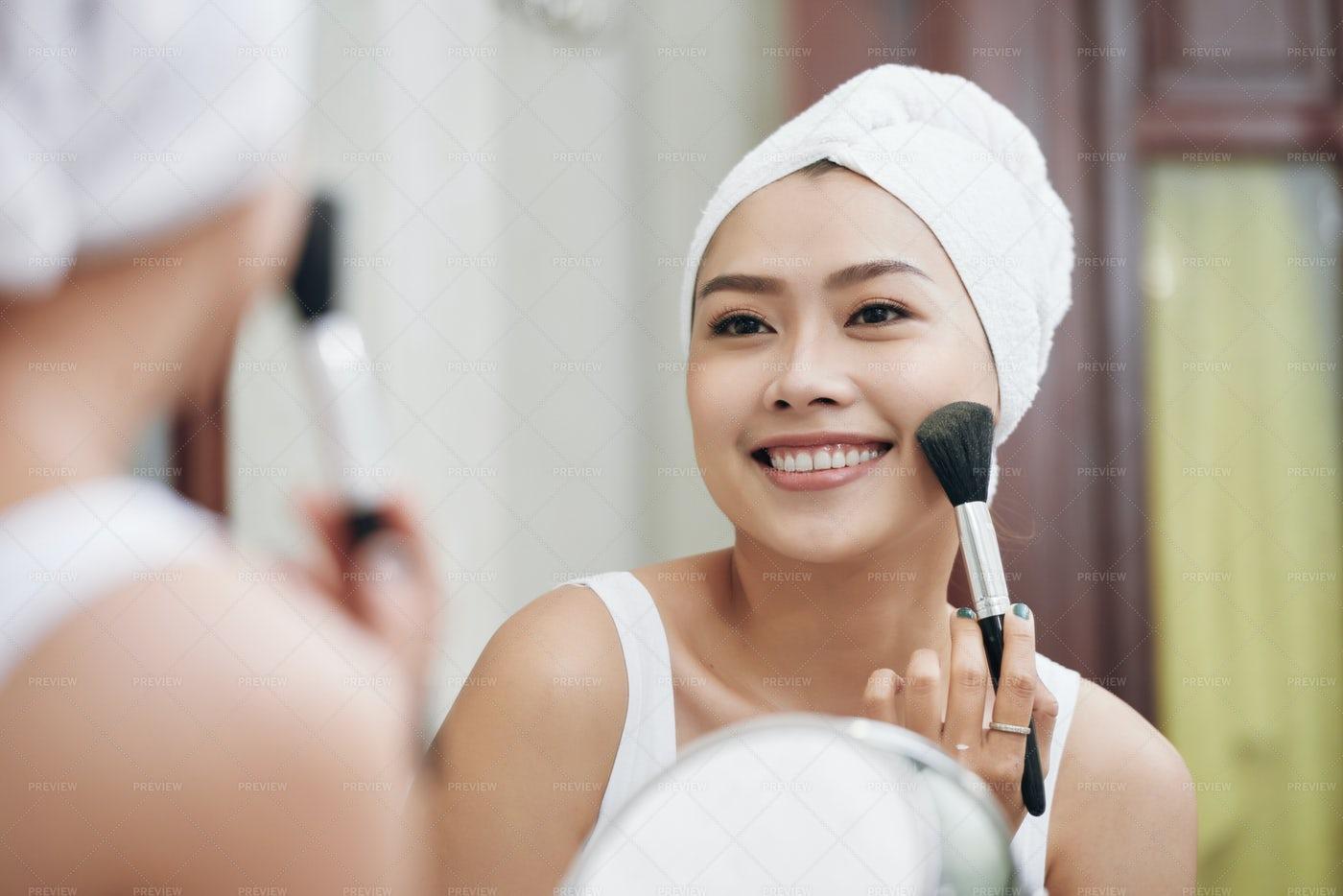 Smiling Woman Applying Makeup In...: Stock Photos