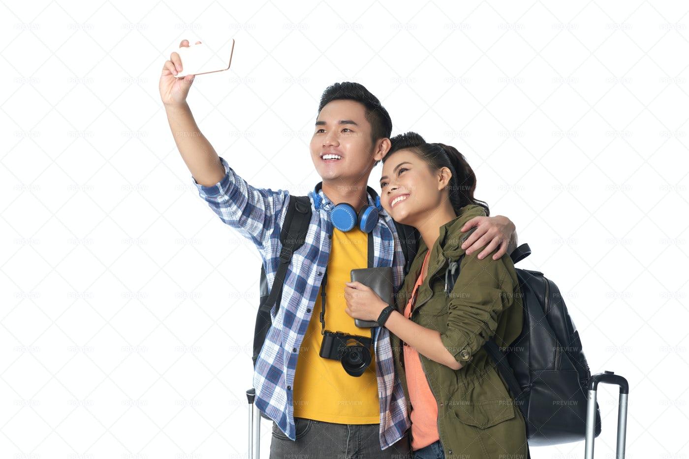 Asian Travelers Taking Selfie: Stock Photos