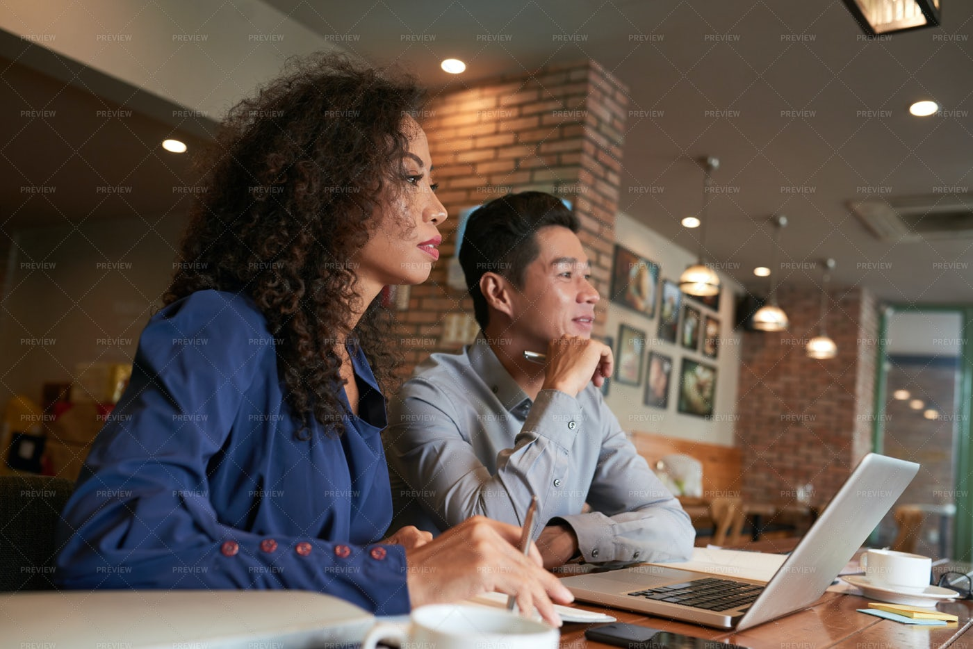 Business People In Cafe: Stock Photos
