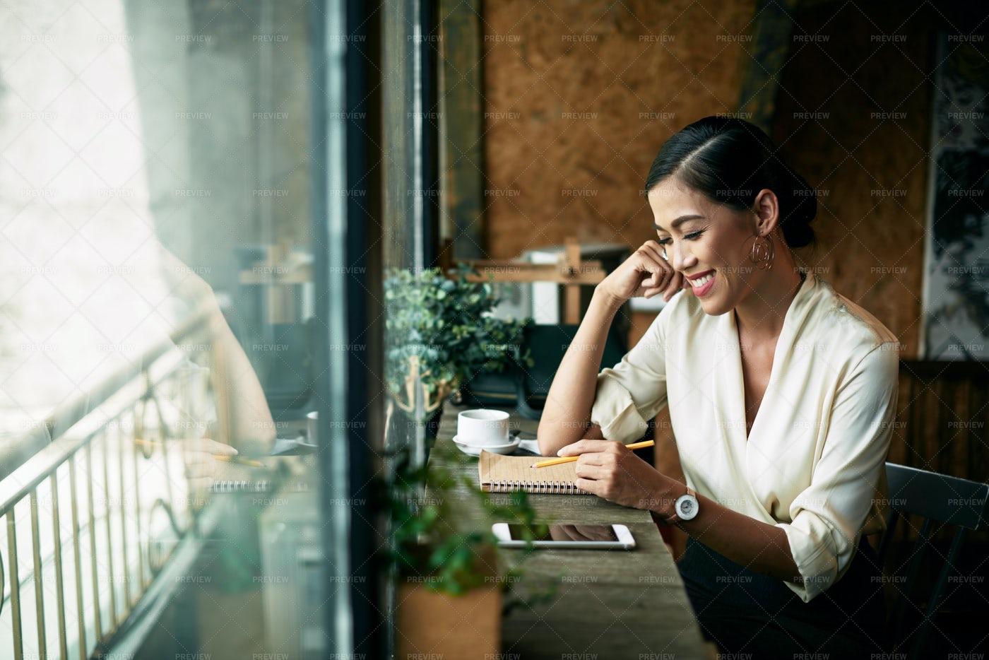 Beautiful Woman In Cafe: Stock Photos