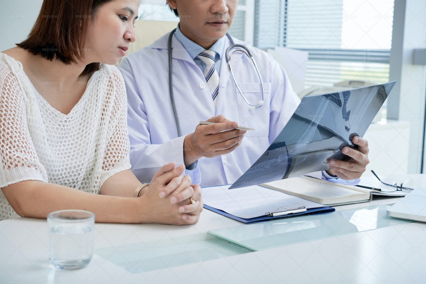 Doctor And Patient Discussing...: Stock Photos