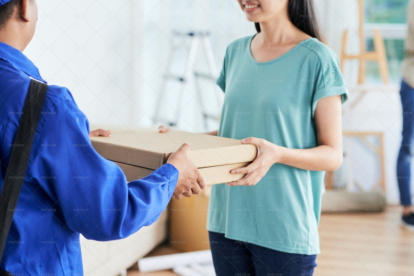 Smiling Woman Taking Pizza From...: Stock Photos