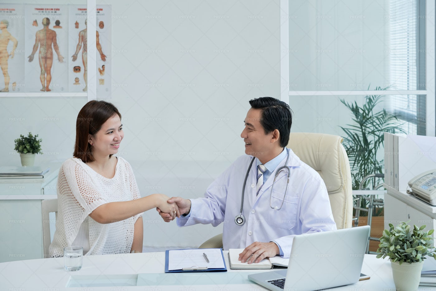 Happy Doctor And Patient: Stock Photos