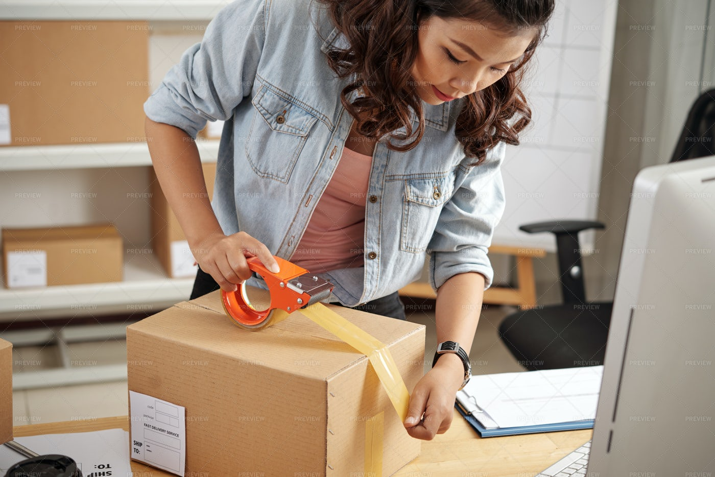 Packing Customer's Orders In Box: Stock Photos