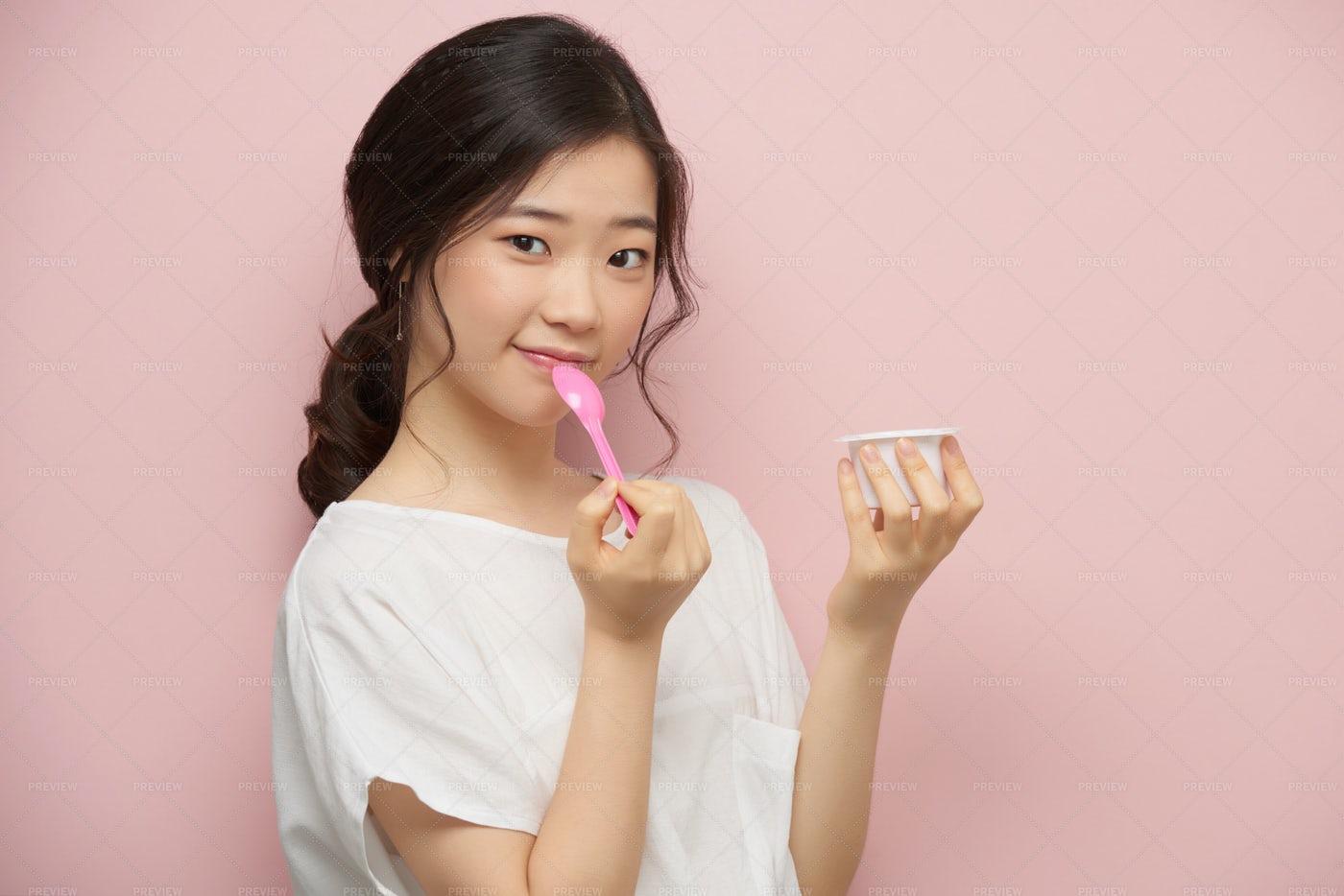 Eating Yogurt: Stock Photos