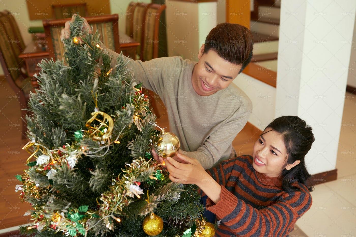 Family Decorating Fir Tree: Stock Photos