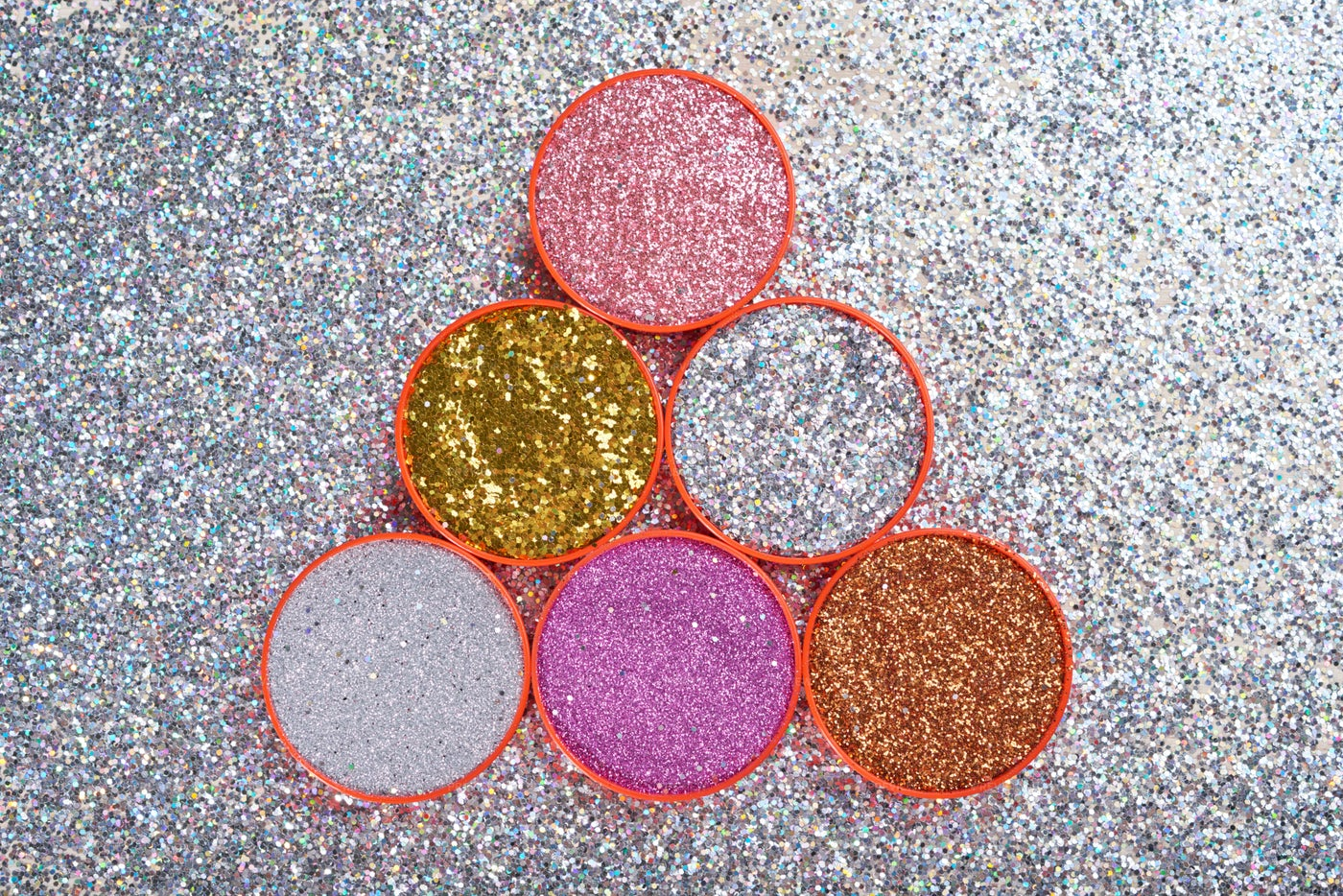 Plastic Lids Filled With Glitters: Stock Photos