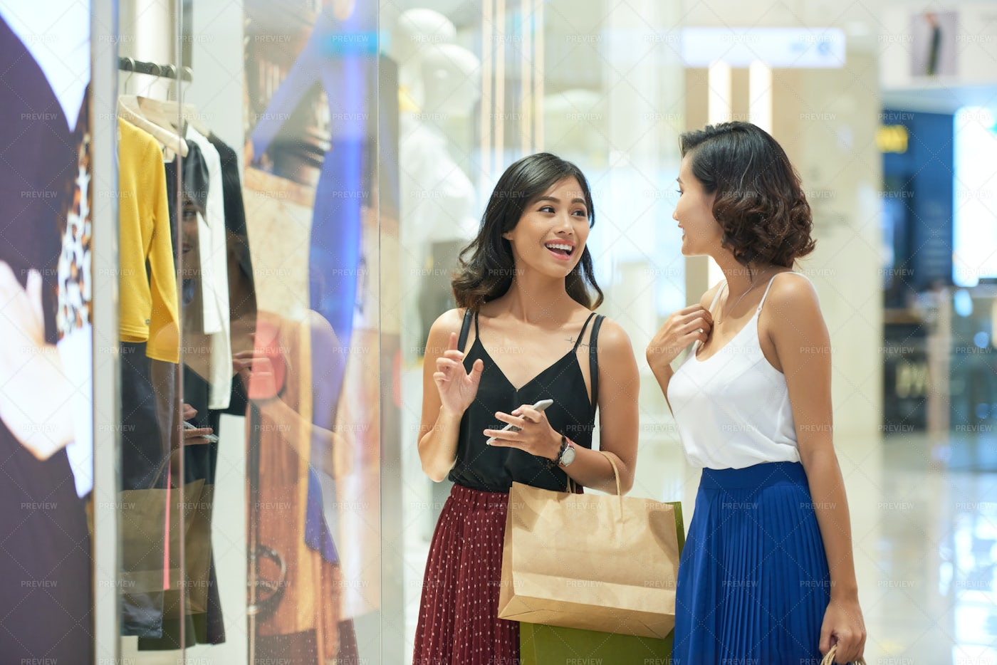 Female Friends In Shopping Mall: Stock Photos