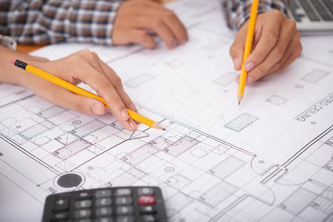 Discussing Construction Plan: Stock Photos