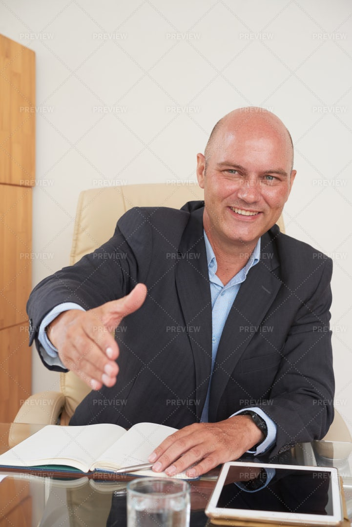 Friendly Professional Sitting At...: Stock Photos