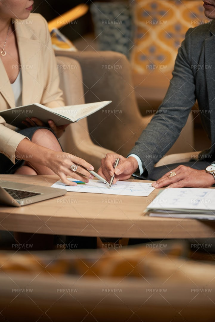 Colleagues Analyzing Document At...: Stock Photos