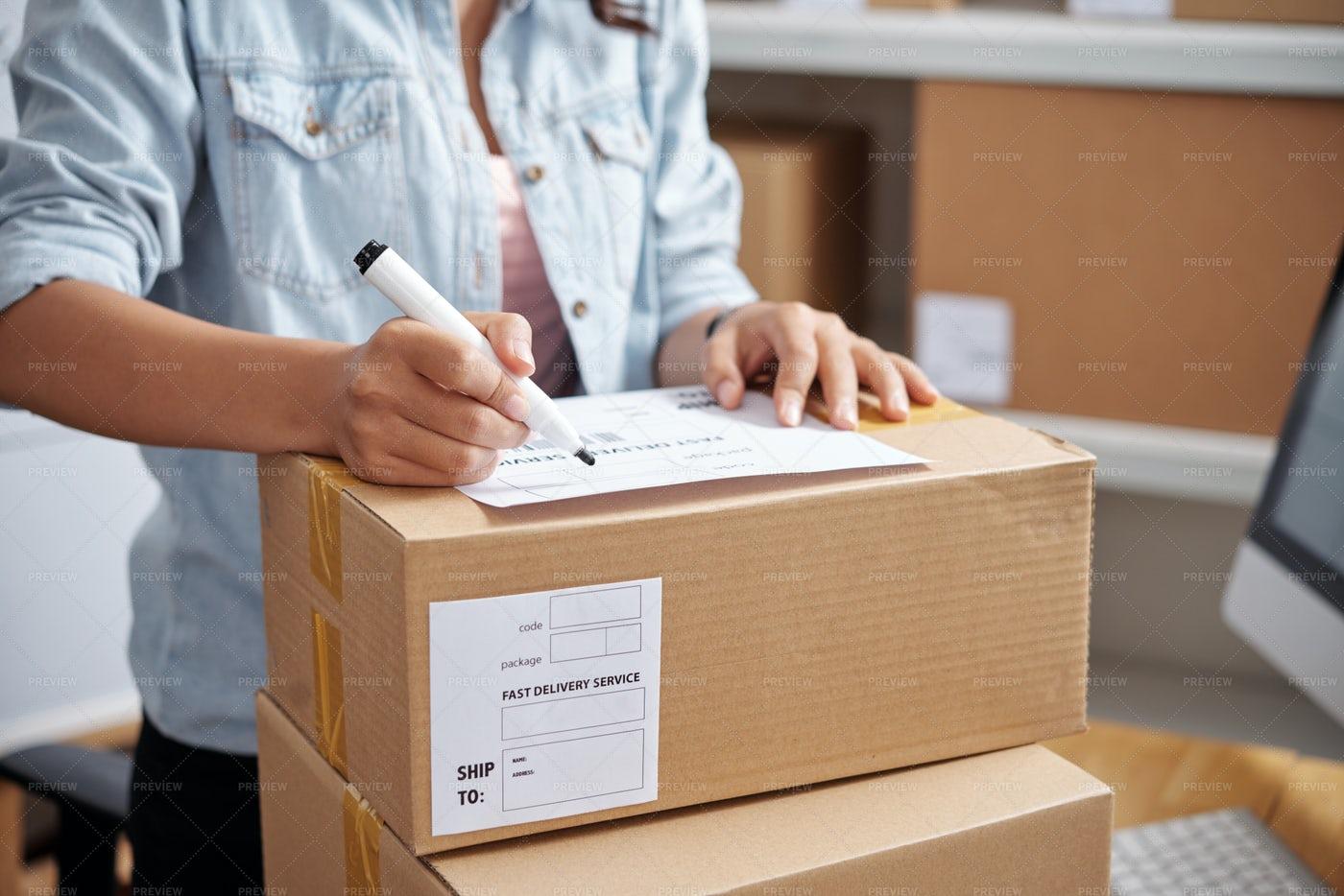 Writing Address On Parcel: Stock Photos