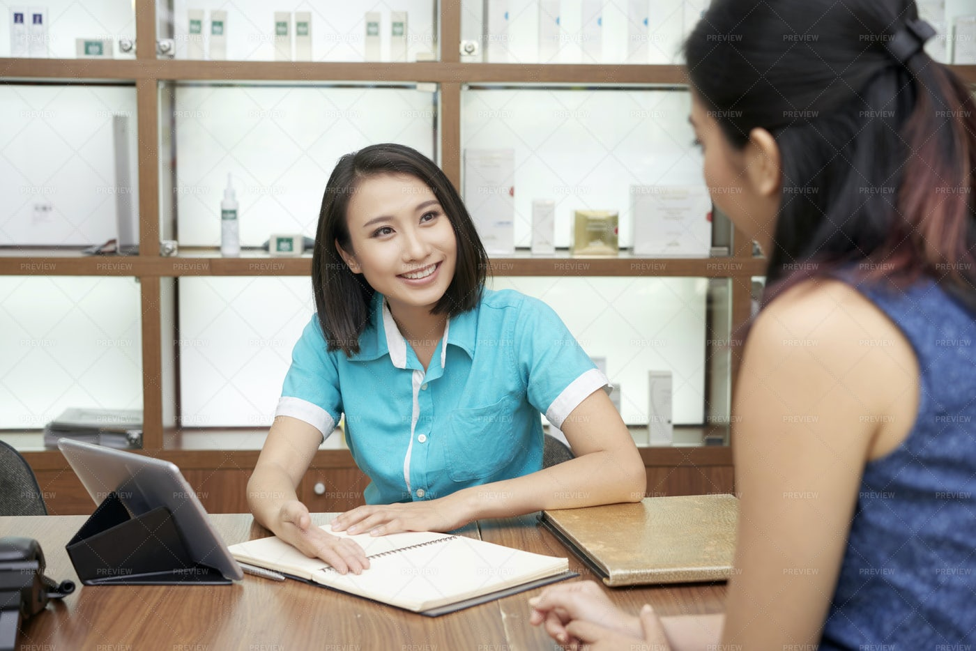 Smiling Receptionist And Client In...: Stock Photos