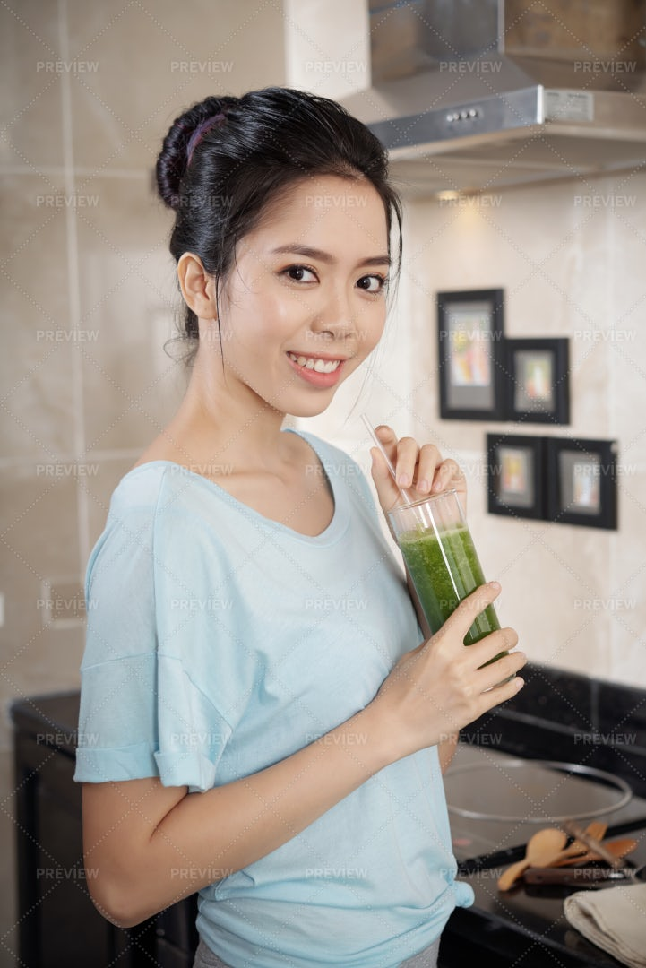Asian Woman With Smoothie In...: Stock Photos