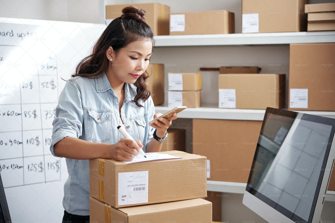 Postwoman Working At Office: Stock Photos