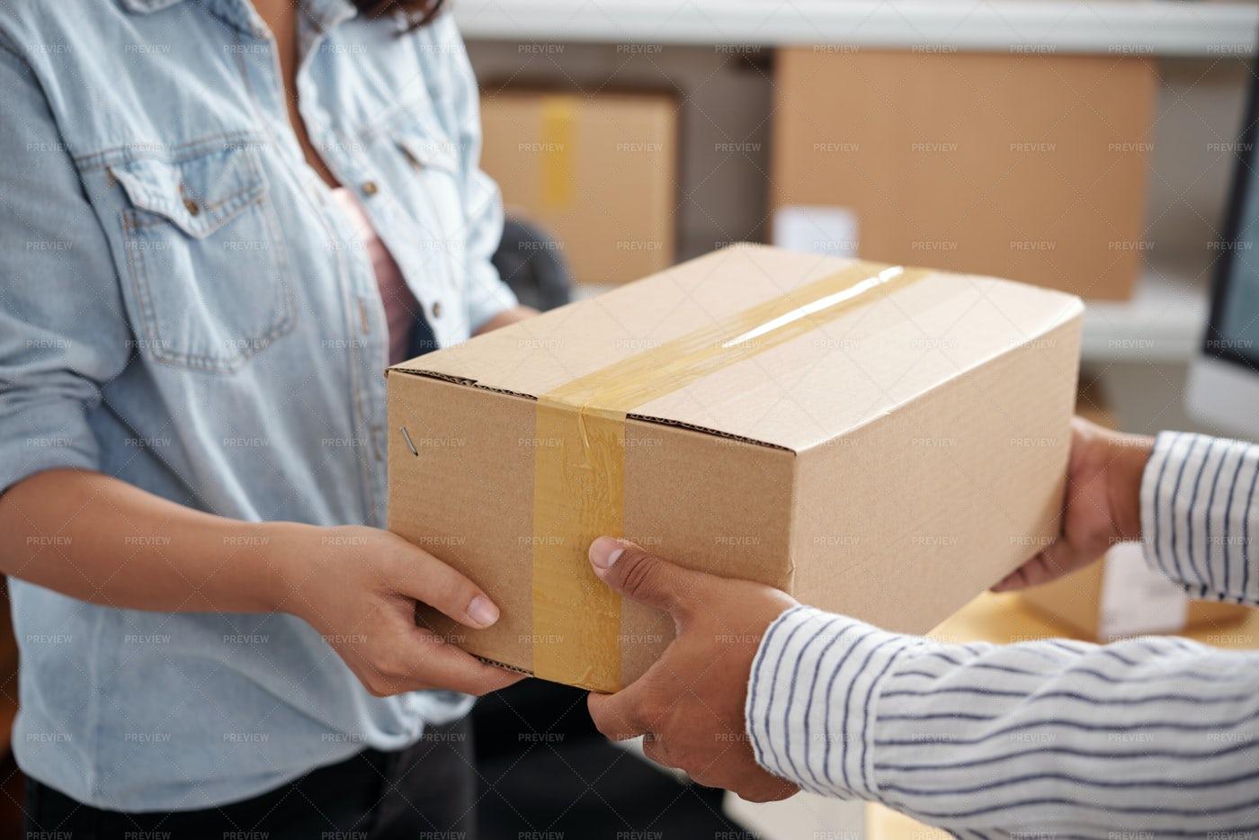 Woman Receiving Parcel: Stock Photos
