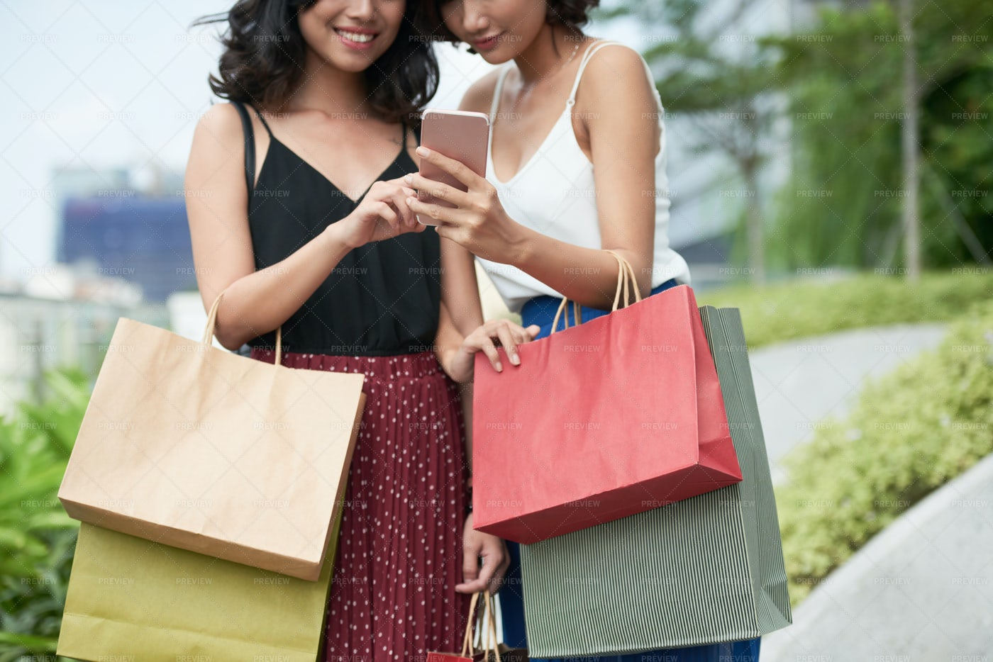 Smiling Women With Smartphone: Stock Photos