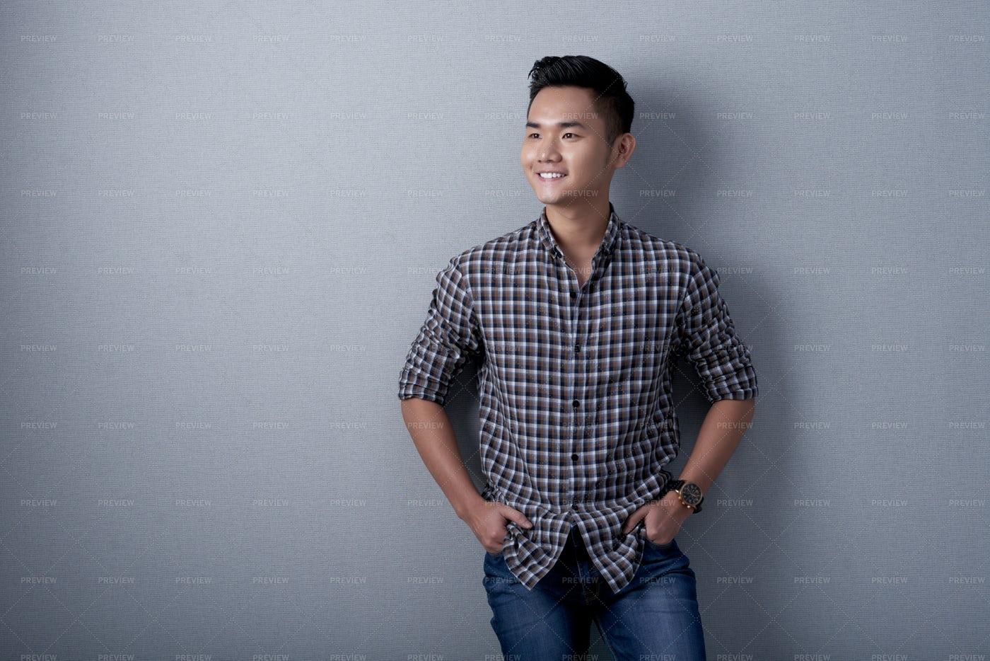 Studio Shot Of Dreamy Asian Man: Stock Photos