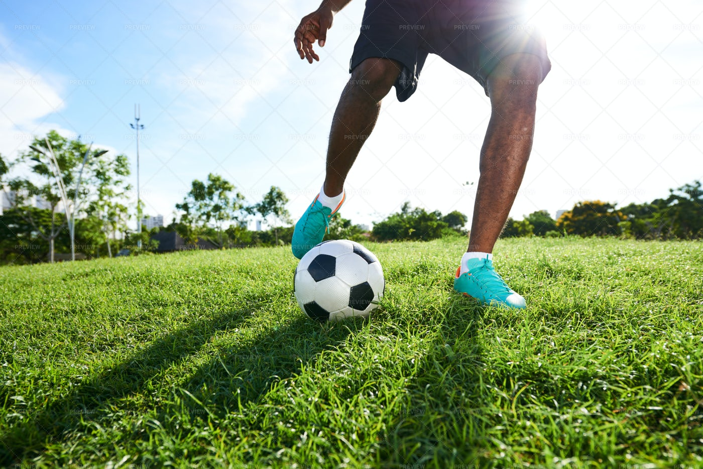 Playing Soccer On Spacious Pitch: Stock Photos