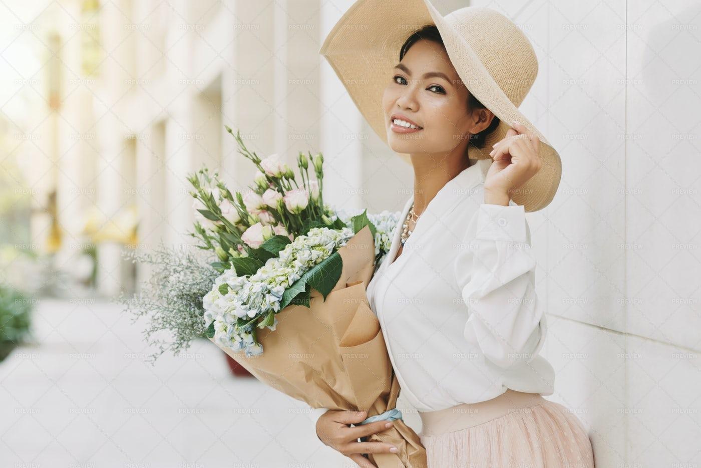 Posing With Flowers: Stock Photos