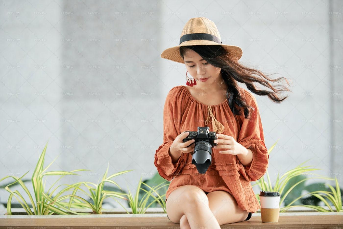 Pretty Photographer Checking Camera: Stock Photos
