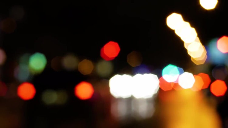 Blurred bokeh at night: Stock Video