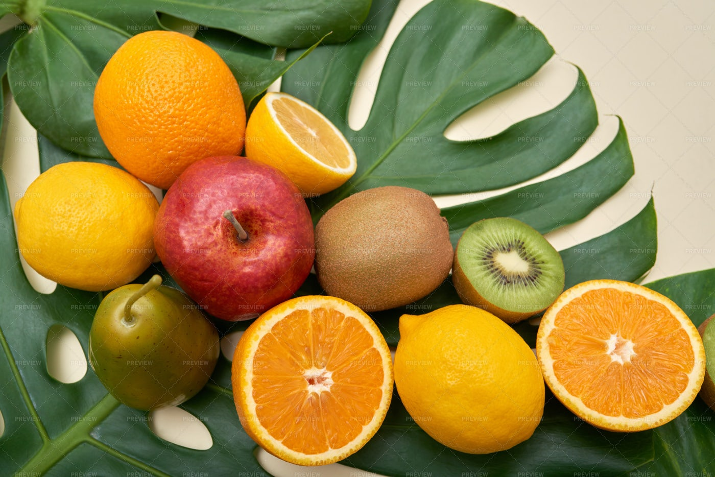 Bright Fruit Mix On Green Leaves: Stock Photos