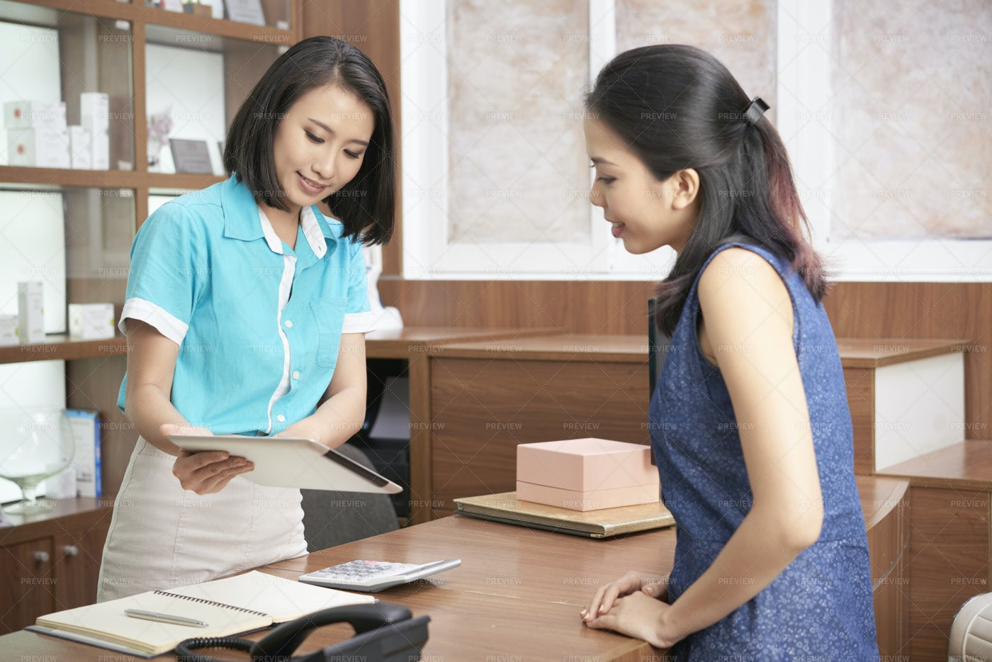 Charming Ethnic Receptionist And...: Stock Photos