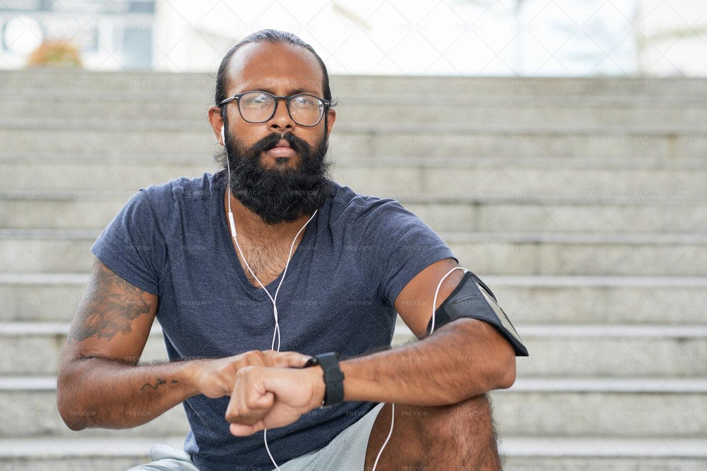 Indian Runner Using Smartwatch: Stock Photos
