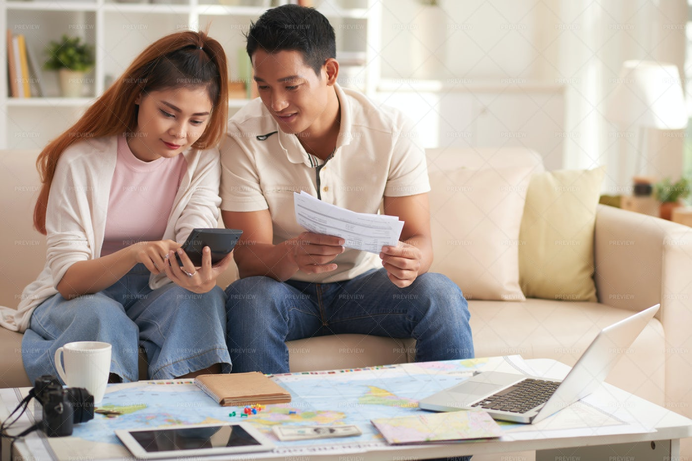 Young Asian Couple Planning...: Stock Photos