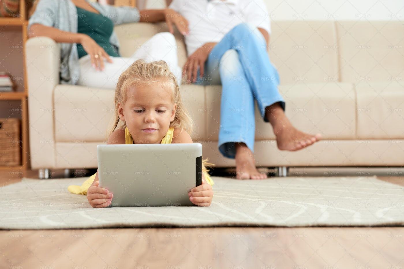 Girl Watching Cartoons: Stock Photos