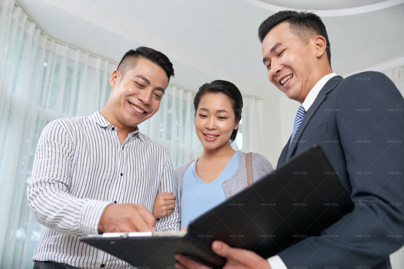 Discussing Contract With Clients: Stock Photos
