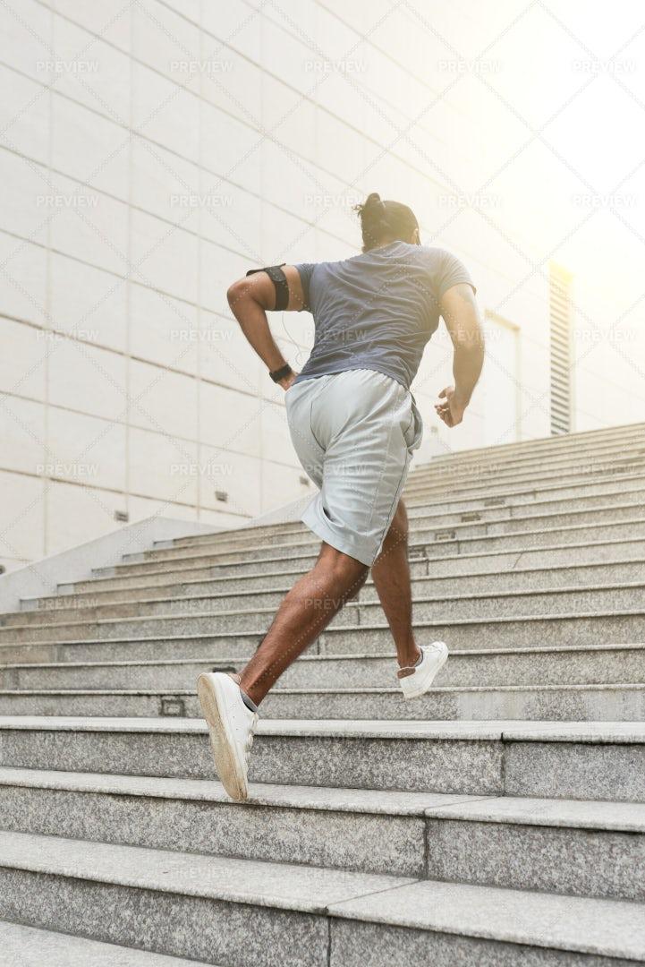 Sportsman Running Up Steps: Stock Photos