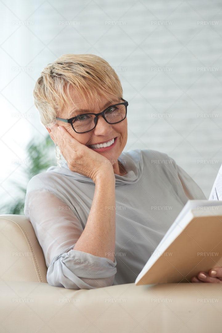 Elderly Woman With A Book: Stock Photos